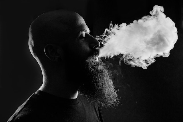 vape-man-smoke-exhale-black-white